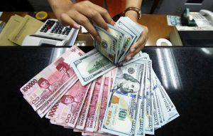uang rupiah dan dolar
